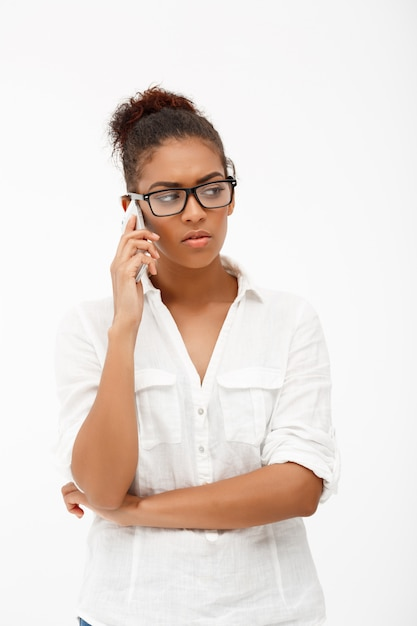 Portrait of young successful african business lady on white ba Free Photo