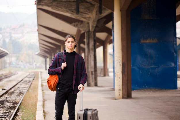 Portrait of young tourist waiting for a train Free Photo