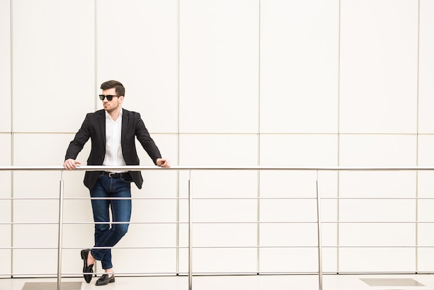 Portrait of young trendy man with black glasses. Premium Photo