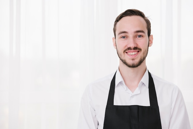 Portrait of young waiter looking at camera Free Photo