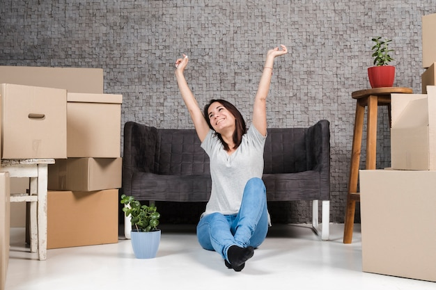 Portrait of young woman celebrating relocation Free Photo