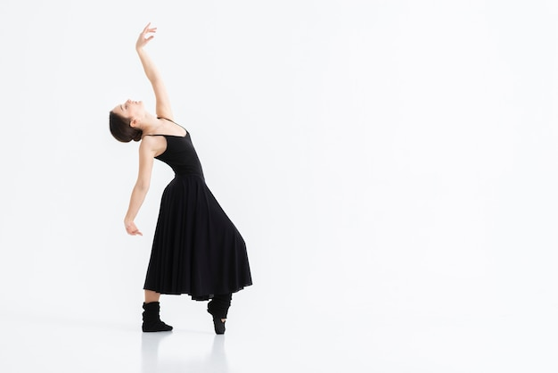 Download this Portrait of young woman dancing with grace Free Photo