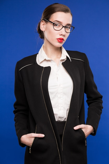 Portrait of a young woman in a dark suit and a white blouse in glasses Premium Photo