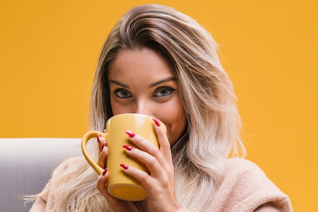 Portrait of young woman drinking coffee at home   Free Photo