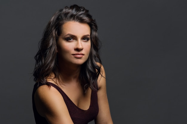Portrait of young woman on grey background Premium Photo