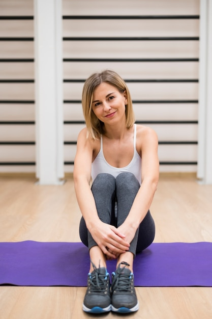 Portrait of young woman at the gym Free Photo