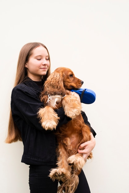 Portrait of young woman hugging her dog Free Photo