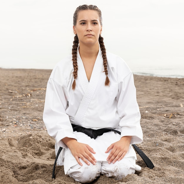 Portrait of young woman in martial art costume Free Photo