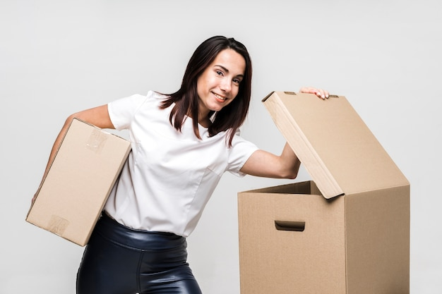 Portrait of young woman posing with boxes Premium Photo
