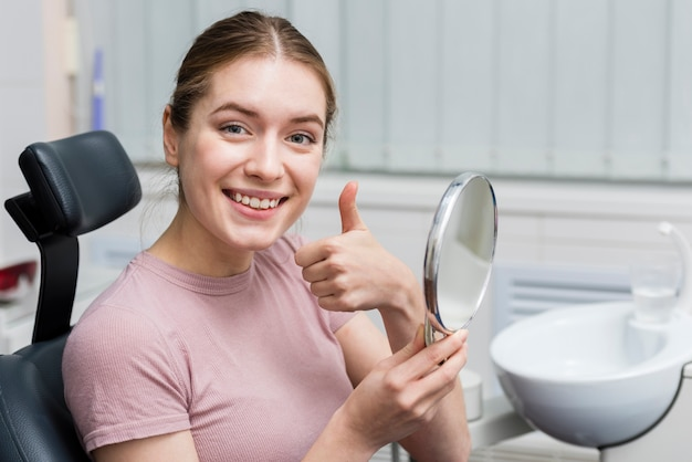 Portrait of young woman smiling Free Photo