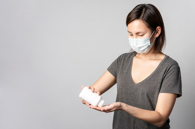 Portrait of young woman taking medical treatment Free Photo
