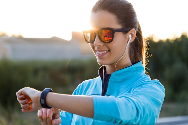 Portrait of young woman using they smartwatch after running. Free Photo