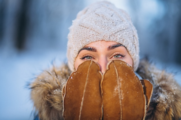 Portrait of young woman in winter jacket Free Photo
