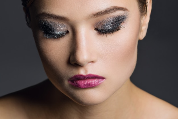 Portrait of young woman with glamorous make-up Premium Photo