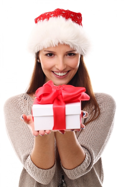 Portrait of young woman with santa hat and gift box Free Photo