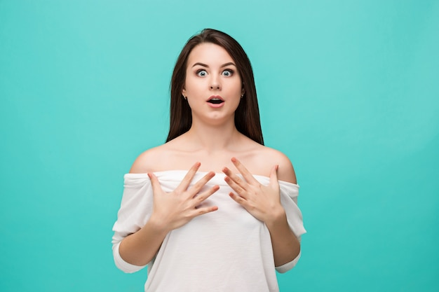 Portrait of young woman with shocked facial expression Free Photo