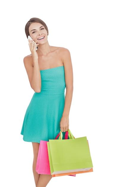 쇼핑백과 세로 젊은 여자 프리미엄 사진