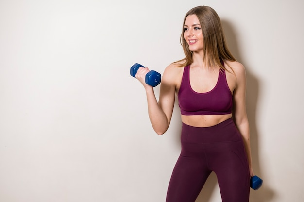 Portrait of young woman working out Free Photo