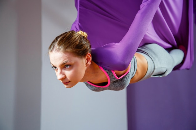 Portrait young women making antigravity yoga. aerial aero fly fitness trainer workout. Premium Photo