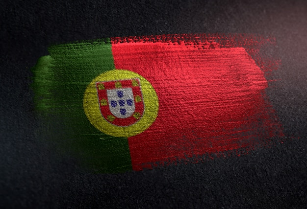 Portugal flag made of metallic brush paint on grunge dark wall Premium Photo