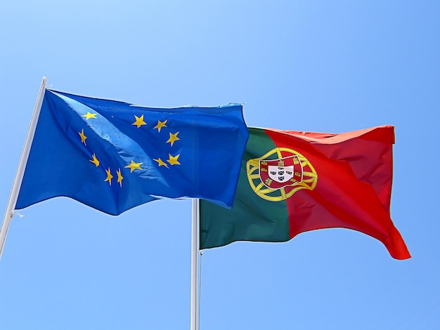 Portuguese and european union flags at the taste of wind. Premium Photo