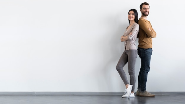 Positive adult male and woman posing with copy space Free Photo