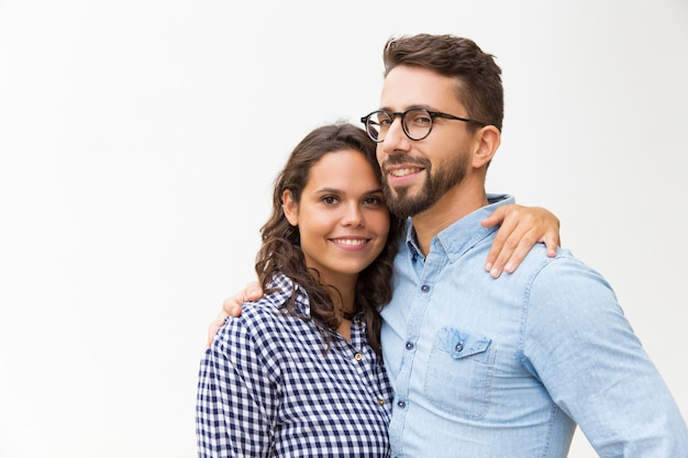 Positive beautiful couple hugging and looking Free Photo