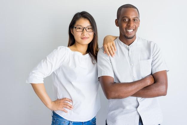 Positive beautiful interracial couple looking at camera. Free Photo