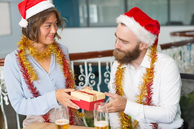 Positive boss in santa hat receiving Free Photo