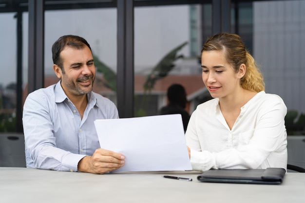 Positive businessman asking expert to check documents Free Photo