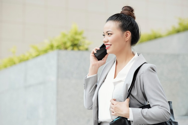 Positive calling businesswoman Free Photo