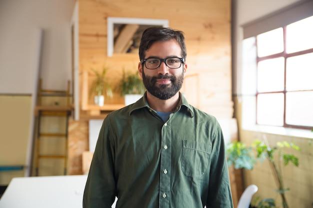 Positive hipster entrepreneur, it expert, software developer Free Photo