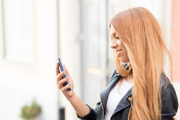 Positive lady making video call on smartphone Free Photo