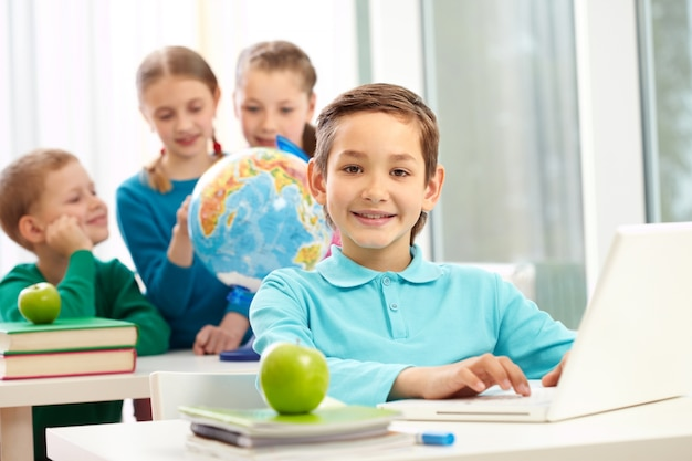 Positive student with classmates background Free Photo