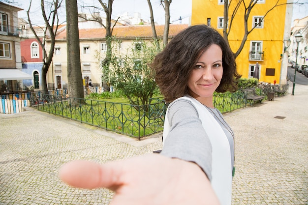 Positive tourist walking around old city Free Photo