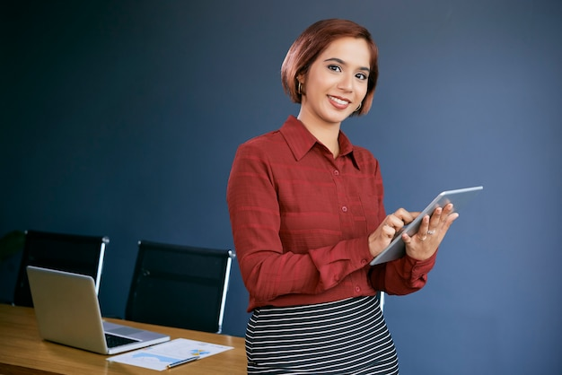 Positive young businesswoman Free Photo