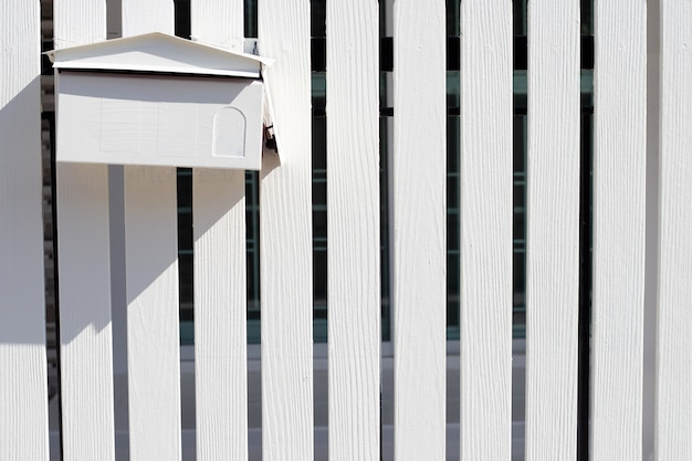 Post box in white wooden fence Premium Photo
