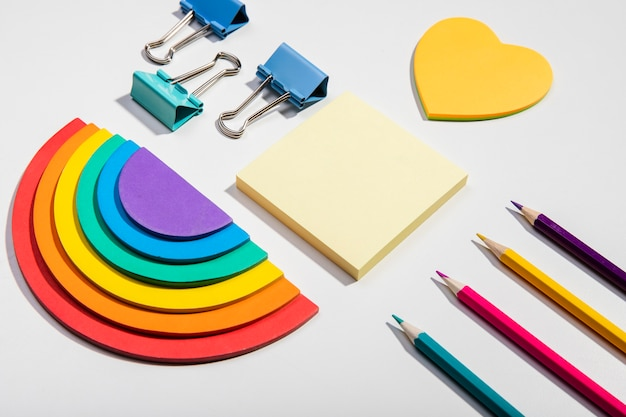 Post-it note cards and school tools and rainbow paper high view Free Photo