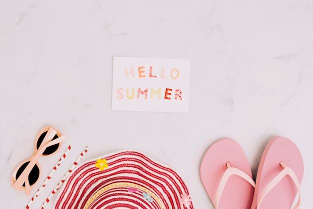 Postcard hello summer with beach accessories Free Photo