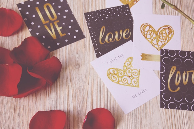 Postcards valentines and rose petals Free Photo