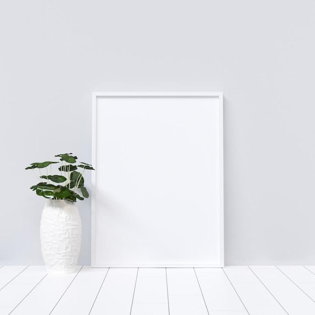 Poster mockup on white interior with plant decoration Premium Photo