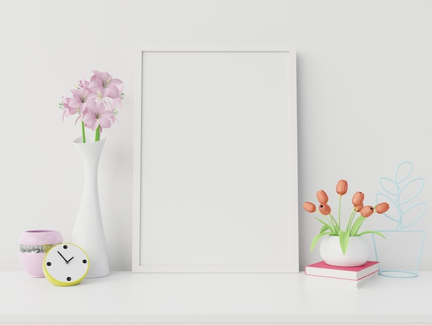 Poster mockup with vertical frame and right/left have book,flower white wall background,3d rendering Premium Photo