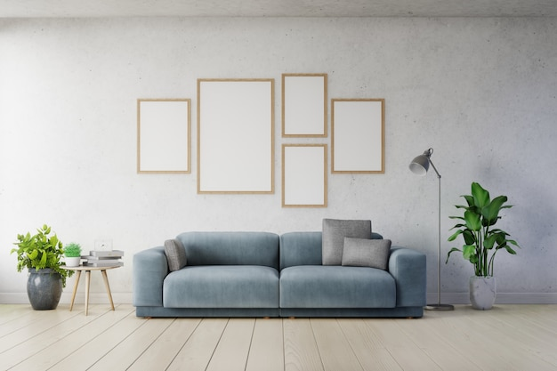 Poster mockup with vertical frames on empty white wall in living room interior ad dark blue sofa. Premium Photo