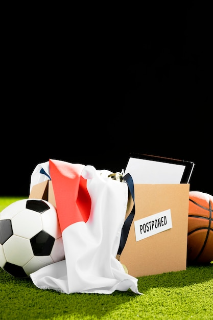Postponed sports event objects arrangement in box Free Photo
