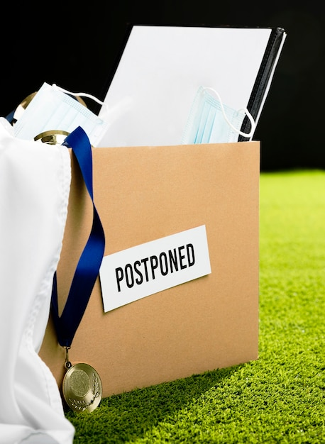 Postponed sports event objects assortment in box Free Photo