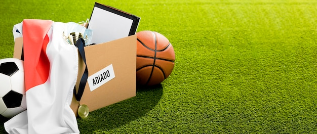 Postponed sports event objects in box with copy space Free Photo