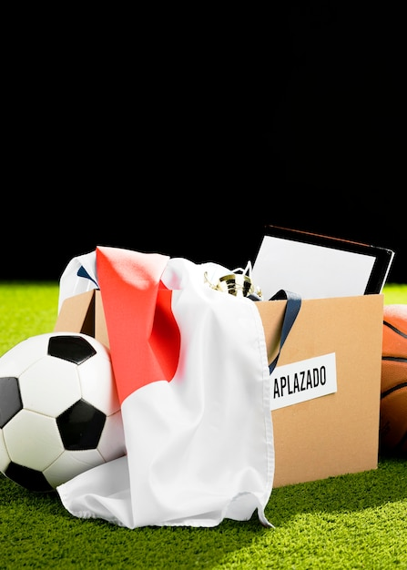 Postponed sports event objects in box Free Photo