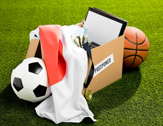 Postponed sports event objects composition in box Free Photo