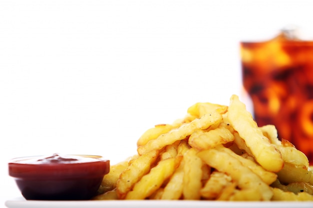 Potato fry with ketchup and cola drink Free Photo