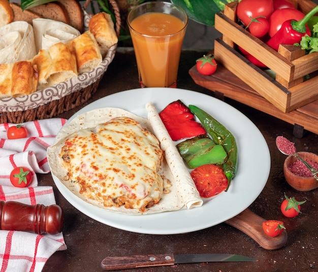 Potato gratin (baked potatoes with cream and cheese) with lavash and grilled red green pepper Free Photo